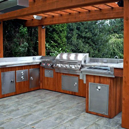 Outdoor kitchen with built-in BBQ